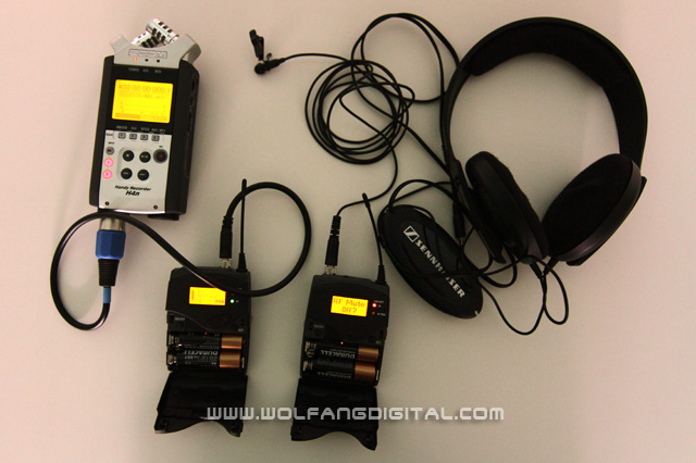 Audio recording gear for interviews: Wireless transmitter & wireless receiver, audio recorder and headphones.