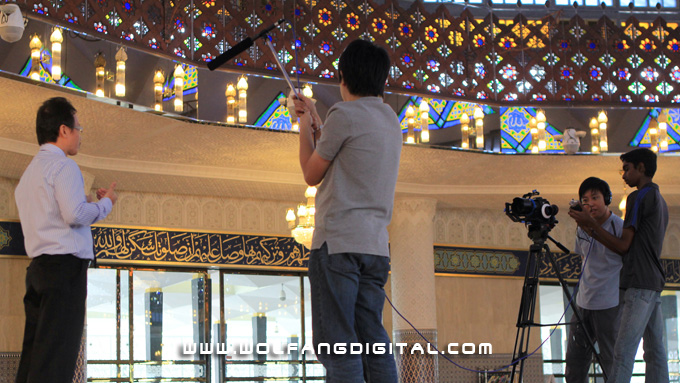 Conducting interviews with Bosch's engineers inside the National Mosque using shotgun mic and H4N audio recorder.