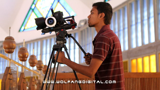 HDSLR with RedRock Micro Follow Focus. Digital Film Making student Kanageswaran prepares to shoot the main prayer hall filled with worshippers during Friday prayers.