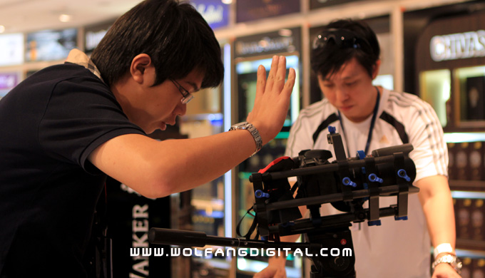 Digital Film Making student Aaron Gan helps to spot the camera's position during a particularly tough dolly move
