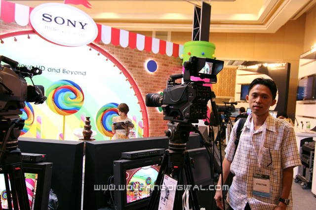 Pai checking out high-end studio news cameras in Sony's booth at Asia-Pacific Broadcasting Union.