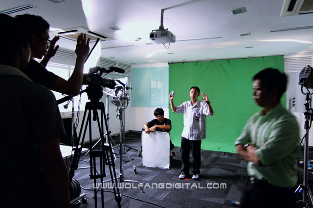 Ong Kok Pai from Brunei (center) experiences what it's like in a professional chroma key interview shoot.
