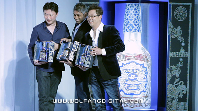 Terence Ong (R), William Lee (L) and Ventakesh Raj (C) reveal the Chivas Regal 18 by Chrisitan Lacroix limited edition bottle