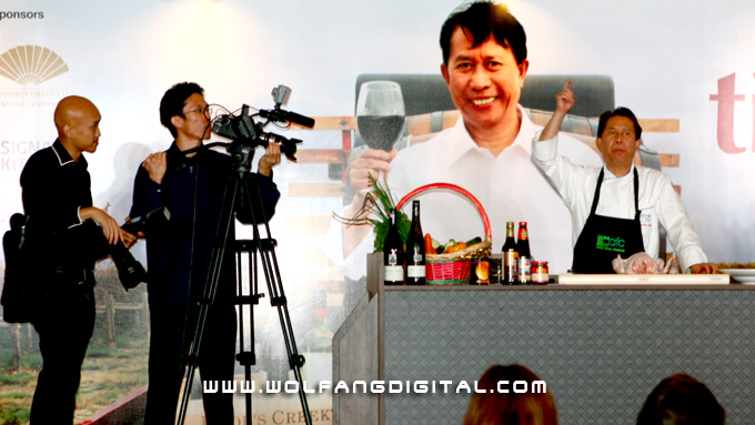 Cinematographer Chiau Ran providing live video feed for Chef Martin Yan's cooking demonstration