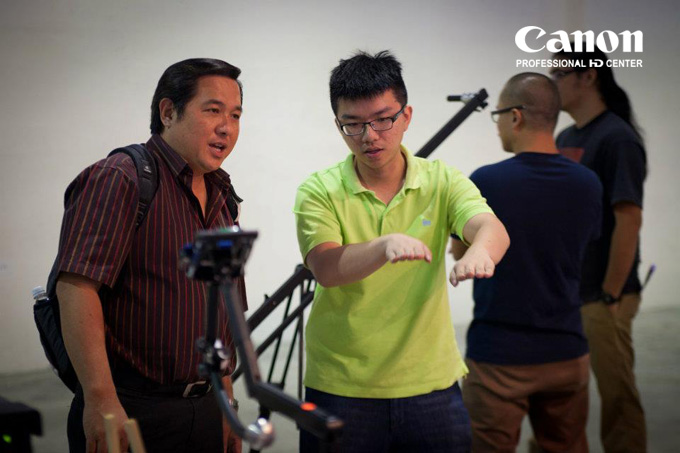 Adrian Chua looks like he's doing a good job helping a customer understand the jib.