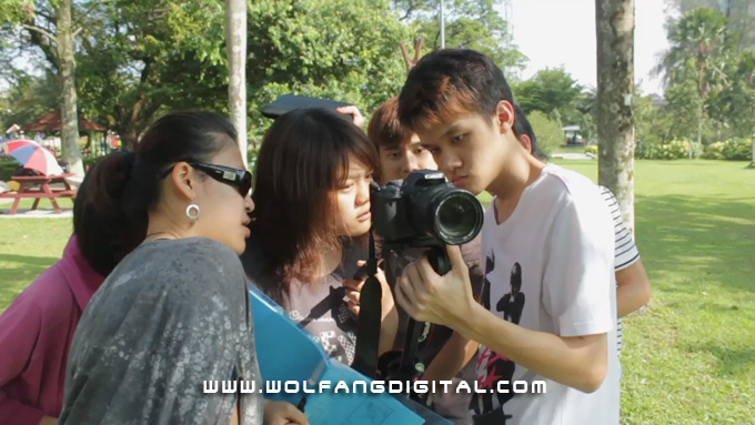 One of the ingredients of a great film: great teamwork. Film Director Yoke Cheng reviews a shot with cinematographer Kok Siong.