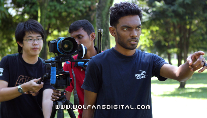 Shanker (from Sri Lanka) prepares himself for his speaking scene while the others operate the camera