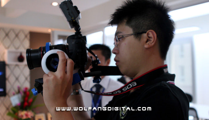 Digital Film Making student Aaron Gan handling the Captain Stubling in an actual event for the launch of a new office