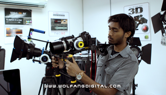 Thiyaga showing off the Ikan Shoulder Mount Deluxe (USA). This config shows Canon 5D MK II with lens EF 70-200mm f4L